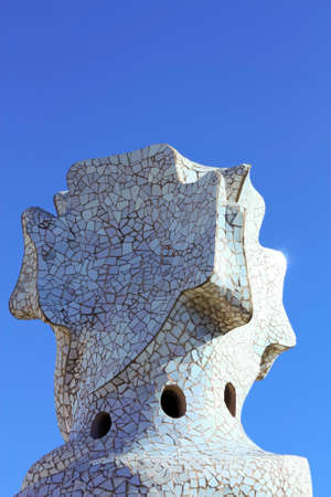diurnal: On the terrace of the Casa Mila also called La Pedrera is a cross-shaped chimneys and soldiers of anthropomorphic forms created by Antonio Gaudi. It was created in 1905. Photo background.