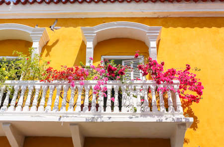 colonial house: Cartagena - the colonial city in Colombia is a beautifllly set city, packed with historical monuments and architectural treasures. The picture present facade of the colonial house with balconies
