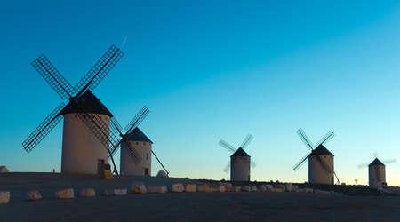 don quixote: Sunrise in Castile. Campo de Criptana, Castile-La Mancha, Spain.  In Campo de Criptana where Don Quixote mistakes windmills for giants, in the book of Miguel de Cervantes. Stock Photo
