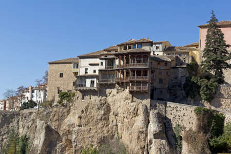 translated: The Casas Colgadas (translated as Hanging Houses), also known as Casas Voladas, Casas del Rey and, erroneusly, Casas Colgantes, is a complex of civil houses located in Cuenca, Spain. Stock Photo