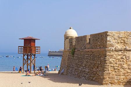 watchman: CADIZ, SPAIN - AGO 10: Caleta beach on August 10, 2013 in Cadiz, Spain. Caleta beach, in the middle of the old city, is the most popular of the beaches of Cadiz.