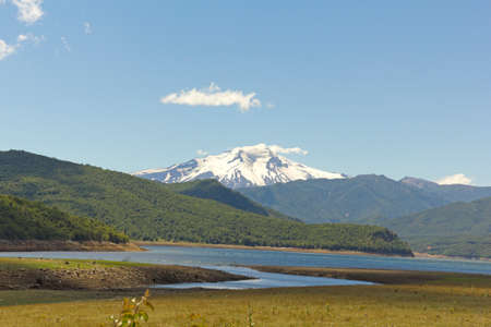 america countryside: Nalcas National Park, Chile. The Bio Bio river, and in the background snowy volcano Lonquimay Stock Photo