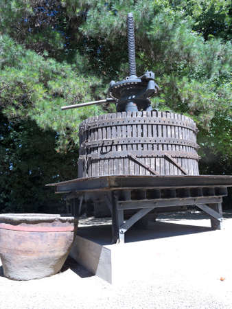 Ancient wine press. Traditional old technique of winemaking.