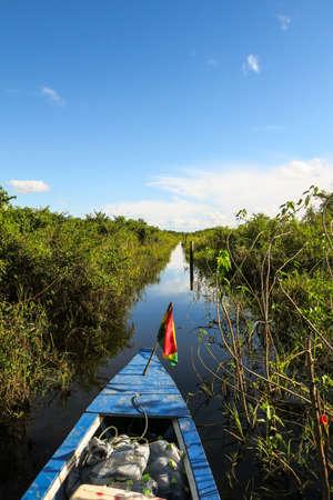 dawning: Boat Crossing the Amazon.  Beni region, Pampas de Yacuma, Bolivia. Stock Photo