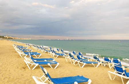 mediterranea: deckchairs on a pebbled beach, facing out to sea Stock Photo