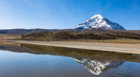 montane: Sajama volcano and lake Huañacota, in the Natural Park of Sajama. Bolivia