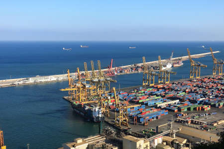dockside: BARCELONA, SPAIN - JULY 23, 2015: Port of Barcelona - logistics port area in Barcelona. Has more than 3,000 metres of berthing line, 17 container cranes Editorial
