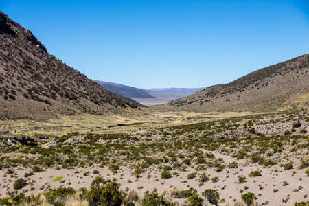 Landscape of an arid valley in the Andean highlands of Latin America Stock Photo