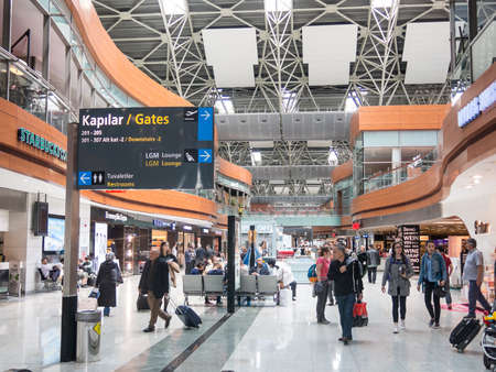 each year: ISTANBUL, TURKEY - MAY 23, 2016: Unidentified people in Departure Hall of Sabiha Gokcen International Airport (SAW) in Istanbul, Turkey. More than 32 million tourists visit Turkey each year. Editorial