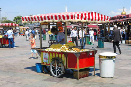 selling service: STANBUL, TURKEY - MAY 20: Unidentified street vendor sells corn on a street on May 20, 2016, Istanbul, Turkey. Editorial