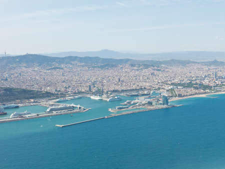 ramblas: Panoramic view of Barcelona and port in Spain. You can see the Tibidabo mountain, Agbar tower, the Sagrada Familia and the Ramblas, among other emblematic buildings of the city