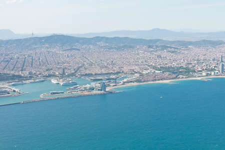 tibidabo: Panoramic view of Barcelona and port in Spain. You can see the Tibidabo mountain, Agbar tower, the Sagrada Familia and the Ramblas, among other emblematic buildings of the city