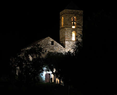 a nocturne: Church of Barruera example of Romanesque art, in the Catalan Pyrenees. valley of Boh� in Catalonia, Spain