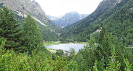 Llebreta pond. Panorama to Aiguestortes National Park in the Catalan Pyrenees, Spain