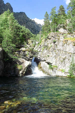 Waterfall Sant Esperit. Panorama to Aiguestortes National Park in the Catalan Pyrenees, Spain