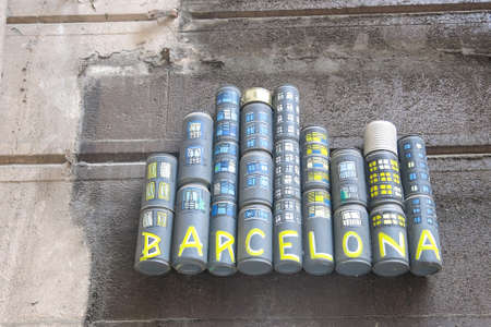 crushed cans: BARCELONA - JUNE 4: Tribute to Barcelona city on June 6, 2016 in Sant Pau street, Barcelona, Spain. The tribute is made with recycled cans and painted.