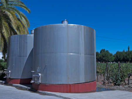 ferment: Some wine metallic fermentation tanks. Wine industry in Chile.
