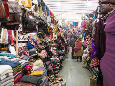 LA PAZ, BOLIVIA - MAY 20, 2015: Souvenir tourist market on Sagarnaga street in La Paz, Bolivia. Predominate handmade products, llama wool or sheep.