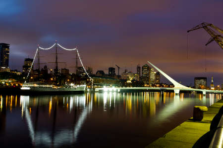 a nocturne: Buenos Aires, Argentina. Puerto Madero by night. its a district at Buenos Aires, occupying a portion of the Rio de la Plata riverbank and representing the latest architectural trends in Buenos Aires Editorial