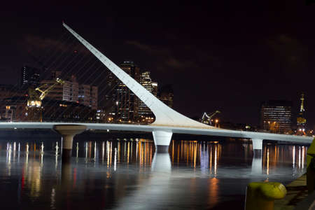 occupying: Buenos Aires, Argentina. Puerto Madero by night. its a district at Buenos Aires, occupying a portion of the Rio de la Plata riverbank and representing the latest architectural trends in Buenos Aires Editorial