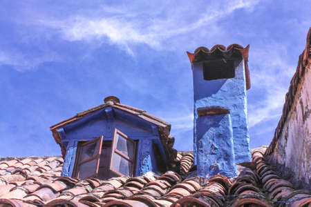 chymeneys in a blue house in the colonial neighborhood of La Candelaria, Bogota, Colombia Stock Photo