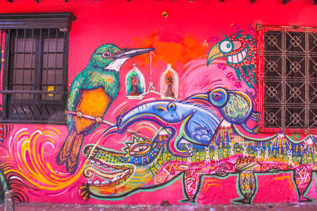 Colonial house with graffiti in the neighborhood of La Candelaria, Bogota, Colombia.