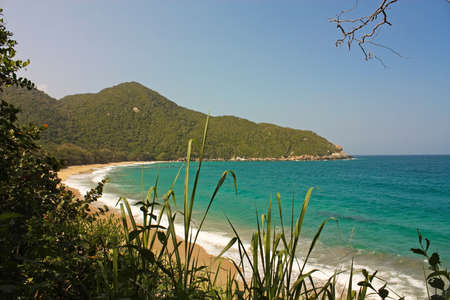 marta: Caribbean beach with tropical forest. Tayrona National Park. Colombia. Tayrona National Park is located in the Caribbean Region in Colombia. 34 km from the city of Santa Marta is one of the most important natural parks of Colombia.
