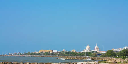 catolic: Overview of Cartagena de Indias, from the coastline. The domes are in the Cathedral of St. Catherine of Alexandria. In 1984, Cartagenas colonial walled city and fortress were designated a UNESCO World Heritage Site.