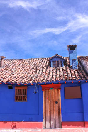 Blue house in the colonial neighborhood of La Candelaria, Bogota, Colombia Editorial