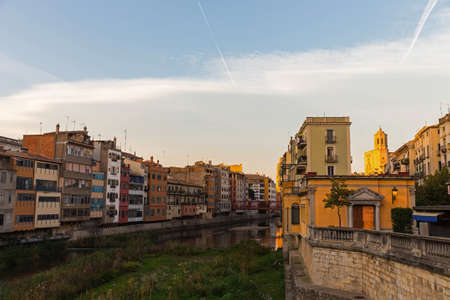 Day view of river Onyar and houses in Girona. In the background, the cathedral. Catalonia, Spain