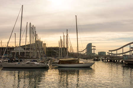 BARCELONA - MAR 1: Sunrise at the port of Barcelona, at the end of the Ramblas on March 1, 2017 in Catalonia, Spain. In the photo, the Ramblas on the sea, the World trade center building and the funicular tower.