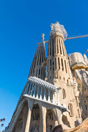 BARCELONA, SPAIN - FEB 10, 2017: La Sagrada Familia - the impressive cathedral designed by Gaudi, which is being build since Mar 19, 1882 and is not finished yet.