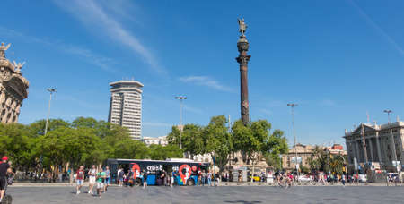 BARCELONA, SPAIN - MAY 16: Tourists near the statue of Christopher Columbus on May 16, 2017 at the lower end of La Rambla.