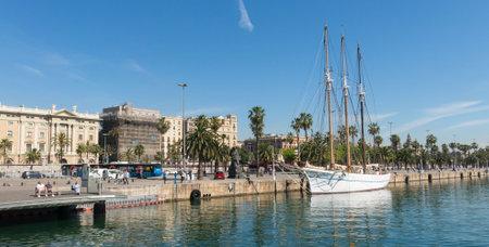 stroll: BARCELONA, SPAIN - MAY 16: Santa Eulalia on May 16, 2017 in Barcelona, Spain. Tourists stroll along the port next to Santa Eulalia, an historical schooner of 1918 on display on Moll de la Fusta