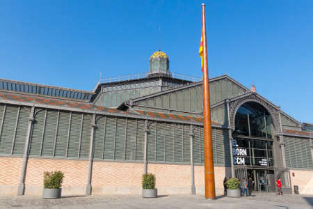 BARCELONA, SPAIN - JUNE 1, 2017: The facade of Born market, and flag of Catalonia. It is an example of iron architecture, a movement within the modernist. Born district. Barcelona, Catalonia, Spain