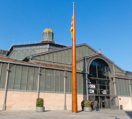 mercat: BARCELONA, SPAIN - JUNE 1, 2017: The facade of Born market, and flag of Catalonia. It is an example of iron architecture, a movement within the modernist. Born district. Barcelona, Catalonia, Spain