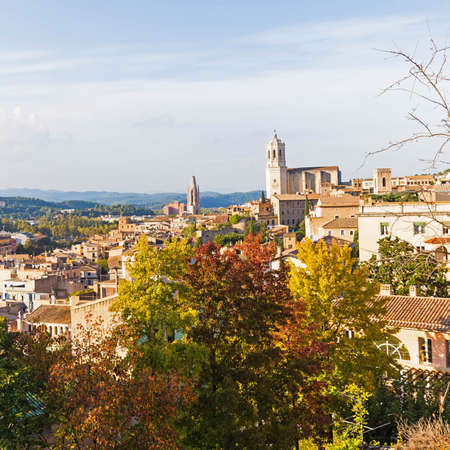 The medieval quarter of Gerona with bell tower of Santa Maria cathedral in background. View from The Forca Vella. Gerona, Costa Brava, Catalonia, Spain.