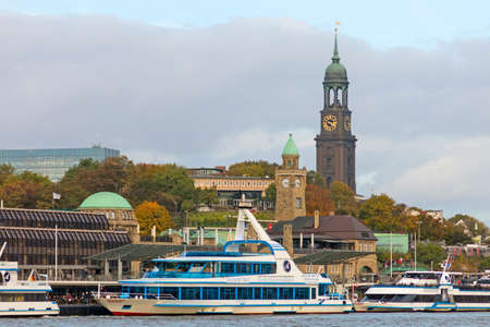 Hamburg, Germany - October 29, 2016. View of the St. Pauli Piers, one of Hamburgs major tourist attractions, with St Michaelis Church and St. Pauli Landungsbrücken.