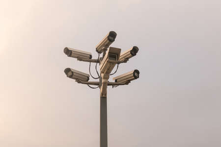 Six cctv security cameras on the street pylon. Security cameras mounting on the high top position Stock Photo