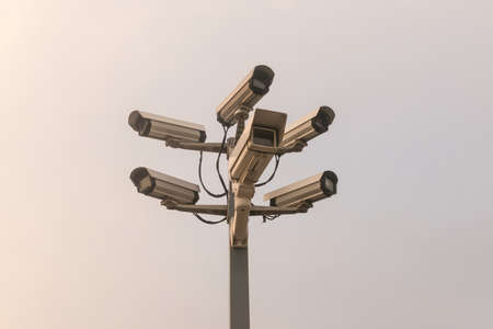 private security: Six cctv security cameras on the street pylon. Security cameras mounting on the high top position Stock Photo