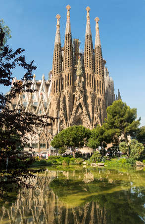 BARCELONA, SPAIN - MAY 18, 2017: Tourists at Nativity facade of La Sagrada Familia - the impressive cathedral designed by Gaudi, which is being build since Mar 19, 1882 and is not finished yet.