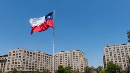 SANTIAGO DE CHILE, CHILE - JANUARY 26, 2018: Chileans walking near the giant flag on Avenida La Alameda with the citizenship Square, in downtown Santiago de Chile. Chile.