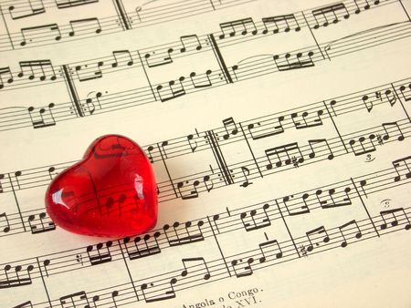 Close up of a music score and a red heart                               Stock Photo
