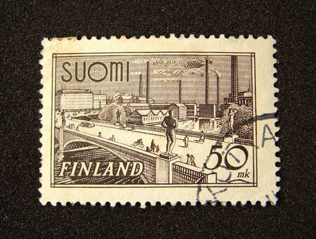 Finland postage stamp on black background.                    Stock Photo
