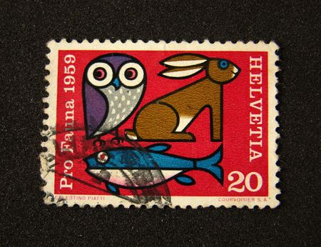 Helvetia (Switzerland) postage stamp on black background.
