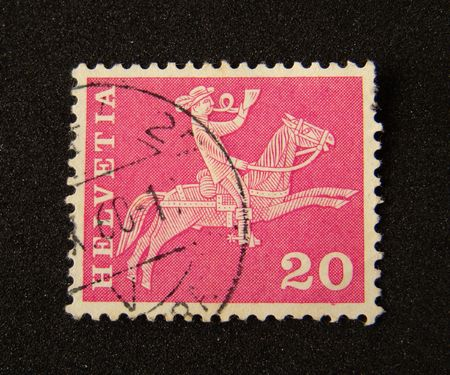 helvetia: Helvetia (Switzerland) postage stamp on black background.