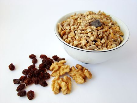Cup of cereals with walnuts and raisin. Stock Photo