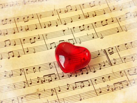 Close of a music score with red heart  Stock Photo - 3663723