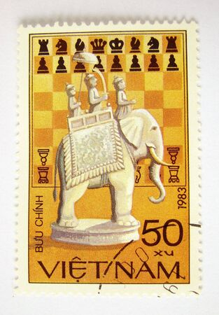 Vietnam postage stamp with chess elephant on white background