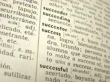 'success' word in english-spanish dictionary - shallow depth of field Stock Photo - 3663733